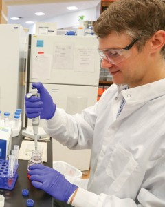An ACC student prepares a solution needed to purify His-tagged Taq polymerase.